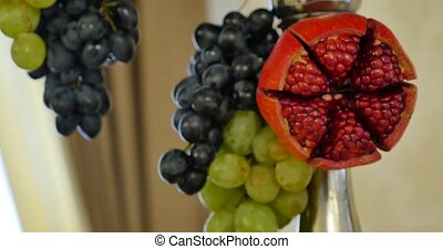 Half pomegranate and pomegranate with grape