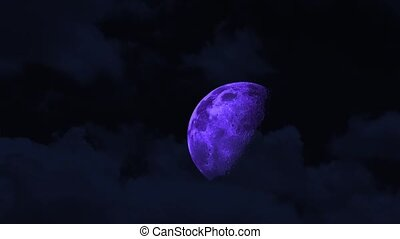 half purple moon rise on the night sky and cloud moving pass