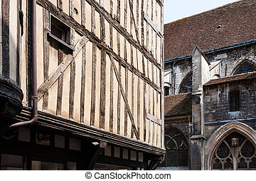 half-timbered house and wall of church in Troyes