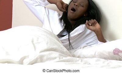 Half-wake woman lying in bed
