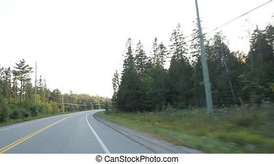 Haliburton corner. - Driving around a corner in the country....