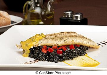 Halibut fillet delight - Plate of halibut fillet over a bed ...