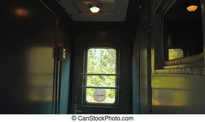 hall corridor inside the railway train car window light from...