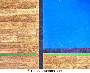 Hall floor in gymnasium with diverse lines. Worn out floor