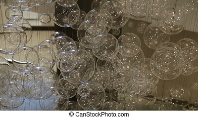 Hall of a hotel or restaurant, chandelier in the lobby, Chandelier hangs from the ceiling, creative, modern, interior, hotel or restaurant interior, Columns, white skin, motions, Bottom view
