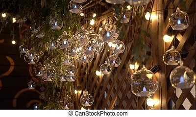 Hall of a hotel or restaurant, chandelier in the lobby, Chandelier hangs from the glass balls, creative, modern, interior, hotel or restaurant interior