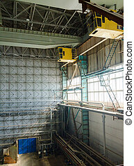 Hall of electric power plant with cranes.
