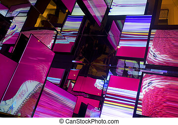 hall of many mirrors reflecting abstract neon lights