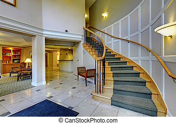 Hall with beautiful staircase and columns