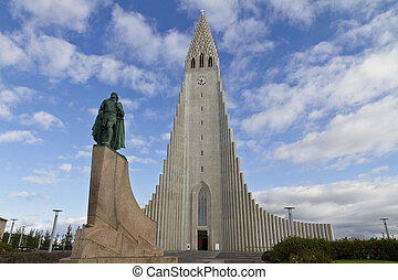 Hallgrimskirkja Church, Reykjavik, Iceland, with statue of Lief Erikson, one of the discoverers of North America. The church architecture echoes the collumnar basalt formations common in Icelandic geology