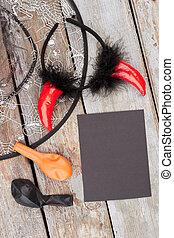 Halloween accessories on wooden background.