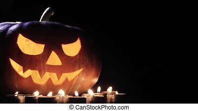 halloween and holidays concept - spooky jack-o-lantern or...