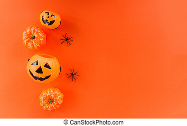 halloween background orange decorated holidays festive concept - spider and jack o lantern pumpkin halloween decorations for party accessories object , top view aerial image flat lay copy space