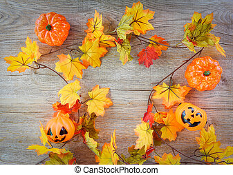 halloween background with dry leaves autumn on wooden decorated holidays festive concept - jack o lantern pumpkin halloween decorations for party accessories object , top view flat lay