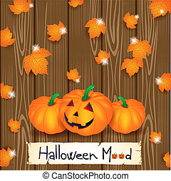 Halloween background with pumpkins and leaves on wood