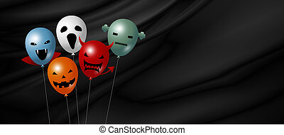 Halloween balloon on black fabric background with copy space