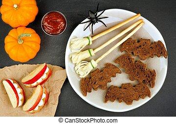 Halloween bat breads, broomsticks and monster apple teeth,...