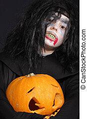 Halloween boy with pumpkin