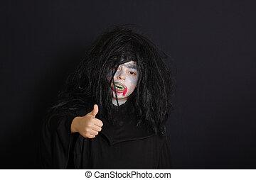 Halloween boy with thumb up