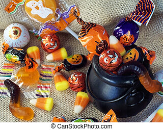 Halloween candy in a mini plastic witches cauldron.