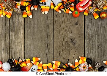 Halloween candy and decor double border against rustic wood...