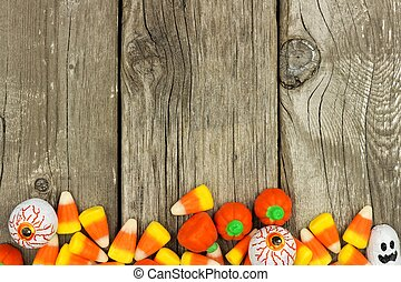 Halloween candy bottom border against a rustic wood background