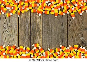 Halloween candy corn double border against wood