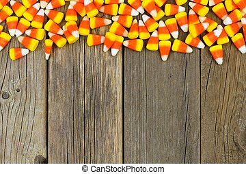 Halloween candy corn top border against wood