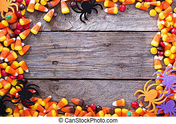 Halloween candy frame around rustic board empty space for...