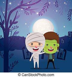 halloween card with kids costumed in dark cemetery scene