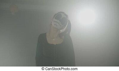 Halloween carnival creepy hell doll skull woman wearing...