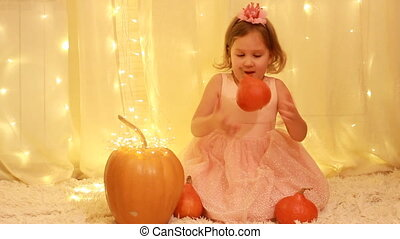 Halloween. Child girl princess with a crown on her head, in...