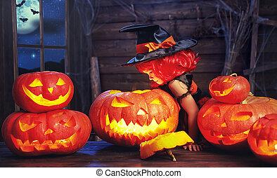 Halloween. child little witch with lantern pumpkin Jack