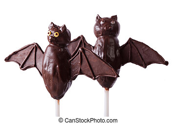 Halloween chocolate cake pop bats isolated on white. horizontal