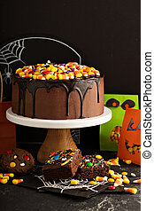 Halloween chocolate cake with candy on top - Halloween...
