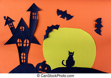 Halloween concept with haunted house castle and black cat and moon and pumpkin on orange background.