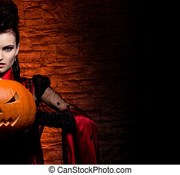 Halloween concept: young and sexy lady vampire in the...