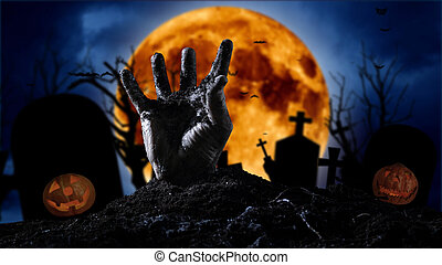 Halloween concept, zombie hand rising out from the ground