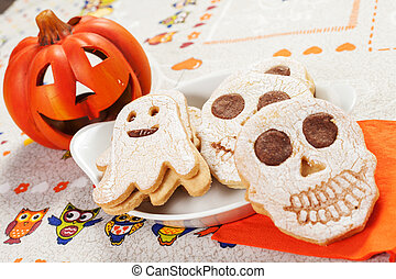 halloween cookies in the shape of ghost and skull