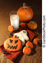Halloween cookies with a glass of milk