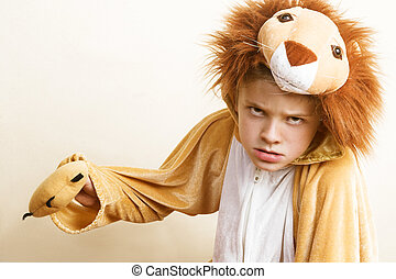 Playful young boy wearing a lion costume