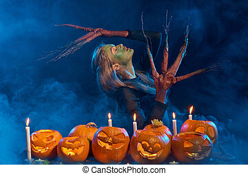Halloween costume woman, tree girl with pumpkins