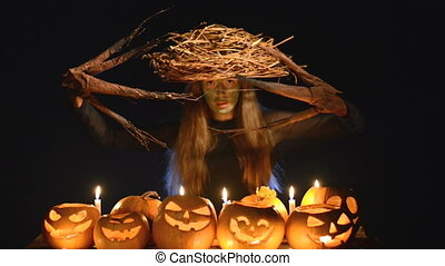 Halloween costume woman, tree girl with pumpkins