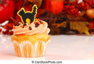 Halloween cupcake with fall foliage