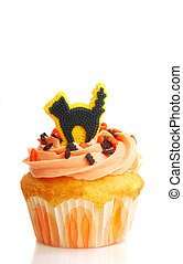 Halloween cupcake with frosting and black cat candy -...