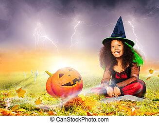 Halloween cute wizard portrait girl with pumpkin
