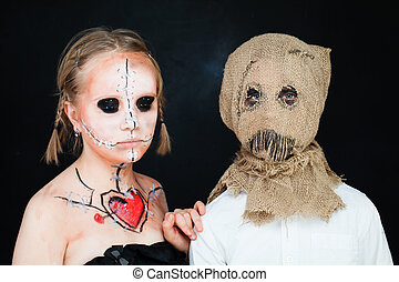 Halloween Dead Doll and Jackstraw. Young Boy and Girl with Halloween Makeup