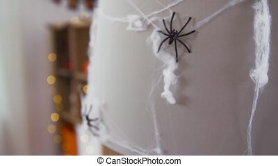 halloween decoration of black toy spider on cobweb - ...