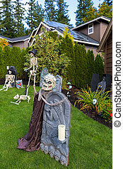 Halloween Decoration on Front Yard Green Lawn