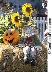 Halloween decoration with scarecrow, pumpkin and sunflowers....